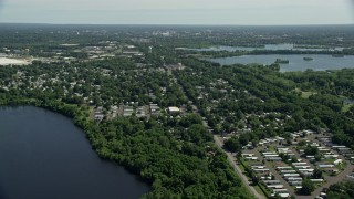 AX82_056 - 5K stock footage aerial video flying over a mobile home park near a lake in Morrisville, Pennsylvania
