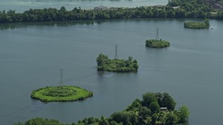 AX82_057 - 5K stock footage aerial video of power lines across Van Sciver Lake, Morrisville, Pennsylvania