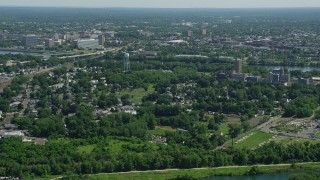AX82_058 - 5K stock footage aerial video flying over homes and cemetery in Morrisville, Pennsylvania, approach Trenton, New Jersey across the Delaware River