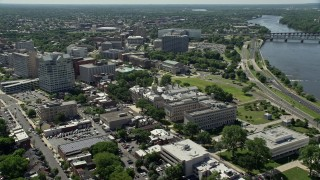 AX82_066 - 5K stock footage aerial video of New Jersey State House, Trenton War Memorial, park, and office buildings, Trenton, New Jersey