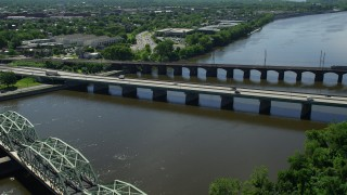 AX82_068 - 5K stock footage aerial video of bridges spanning the Delaware River, reveal Richard J. Hughes Justice Complex, Trenton, New Jersey