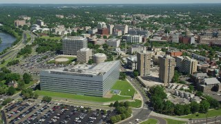 AX82_071 - 5K stock footage aerial video flying over Richard J. Hughes Justice Complex, office and government buildings, Trenton, New Jersey