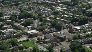 AX82_076 - 5K stock footage aerial video of row houses and apartment buildings in Trenton, New Jersey