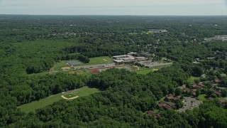 AX82_078 - 5K stock footage aerial video flying over Notre Dame High School and football field in Lawrence Township, New Jersey