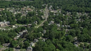 AX82_079 - 5K stock footage aerial video flying by suburban neighborhood in Lawrence Township, New Jersey