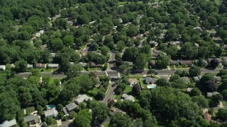 AX82_080 - 5K stock footage aerial video flying over suburban neighborhoods among trees, Lawrenceville, New Jersey