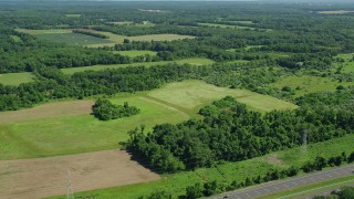 AX82_082 - 5K stock footage aerial video of open fields around a baseball diamond in Lawrenceville, New Jersey