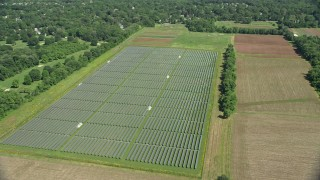 AX82_084 - 5K stock footage aerial video of solar panels and farm fields in Lawrenceville, New Jersey