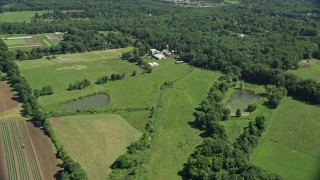 AX82_085 - 5K stock footage aerial video of a farm and farmland in Lawrenceville, New Jersey