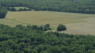 AX82_087 - 5K stock footage aerial video of farmhouse and farm fields in Lawrenceville, New Jersey