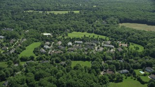 AX82_088 - 5K stock footage aerial video approaching spacious mansions in Princeton, New Jersey