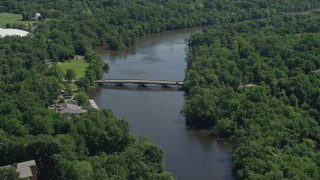 AX82_101 - 5K stock footage aerial video of Shea Rowing Center by Lake Carnegie at Princeton University, New Jersey
