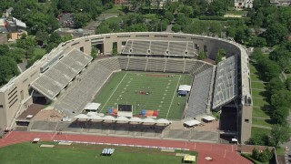 AX82_102 - 5K stock footage aerial video of football practice at Princeton University Stadium, New Jersey