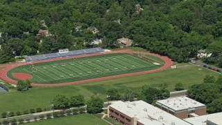 AX82_104 - 5K stock footage aerial video of Princeton High football field, Princeton New Jersey