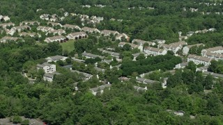 AX82_106 - 5K stock footage aerial video of an apartment complex and trees in Princeton, New Jersey