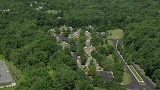 AX82_107 - 5K stock footage aerial video of an office complex bordered by trees, Princeton, New Jersey