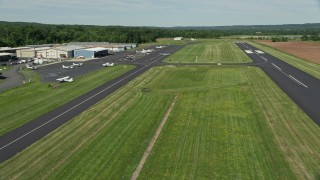 AX82_108 - 5K stock footage aerial video of a small plane taxiing at Princeton Airport, New Jersey