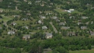 AX83_004 - 5K stock footage aerial video of upscale homes and tree-lined streets in Belle Mead, New Jersey