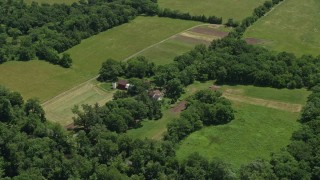 AX83_005 - 5K stock footage aerial video of farmhouse, barns, and fields in Belle Mead, New Jersey