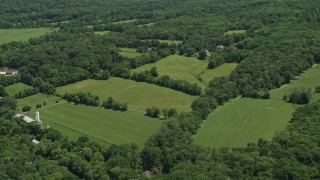 AX83_006 - 5K stock footage aerial video of upscale homes by farm fields, Belle Mead, New Jersey