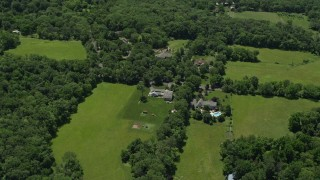 AX83_007 - 5K stock footage aerial video of upscale homes and green fields in Belle Mead, New Jersey
