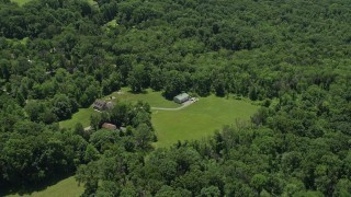 AX83_008 - 5K stock footage aerial video of a rural home with a barn in Belle Mead, New Jersey