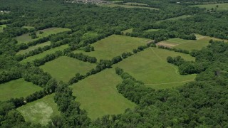 AX83_009 - 5K stock footage aerial video of green fields bordered by trees, Belle Mead, New Jersey