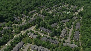 AX83_011 - 5K stock footage aerial video of condominium complex surrounded by forests, Skillman, New Jersey