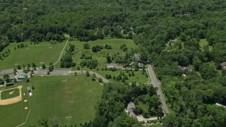 AX83_012 - 5K stock footage aerial video of a baseball field and a country home in Princeton, New Jersey