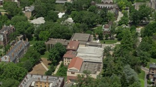 AX83_028 - 5K stock footage aerial video tilting from Princeton University Art Museum to reveal campus buildings and the Chapel, New Jersey
