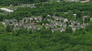 AX83_030 - 5K stock footage aerial video of town houses bordered by trees, Princeton, New Jersey