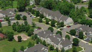 AX83_031 - 5K stock footage aerial video flying over and tilting to town houses in Princeton, New Jersey
