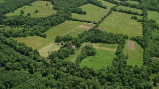 AX83_033 - 5K stock footage aerial video of a farmhouse, barn, and green fields in Belle Mead, New Jersey