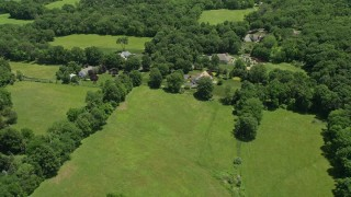 AX83_035 - 5K stock footage aerial video flying by rural homes in Princeton, New Jersey