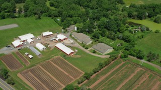 AX83_037 - 5K stock footage aerial video of a farm, red barns, and fields in Princeton, New Jersey