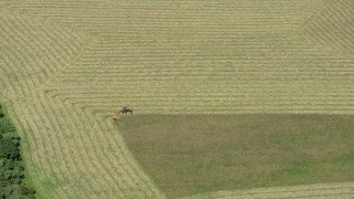 AX83_038 - 5K stock footage aerial video of a tractor harvesting crops in Princeton, New Jersey