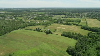 AX83_040 - 5K stock footage aerial video of rural homes and green fields, Franklin Park, New Jersey