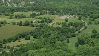 AX83_041 - 5K stock footage aerial video of barns and farmland in Hillsborough Township, New Jersey