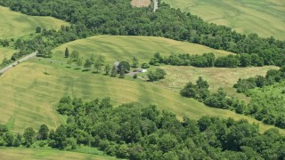 AX83_042 - 5K stock footage aerial video of an isolated rural home and green fields in Hillsborough Township, New Jersey