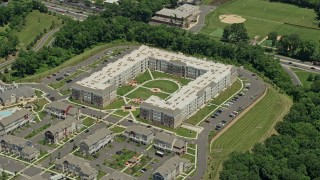 AX83_048 - 5K stock footage aerial video of modern apartment complex in Somerset, New Jersey