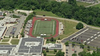 AX83_051 - 5K stock footage aerial video of a high school football field in Piscataway Township, New Jersey