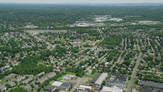 AX83_054 - 5K stock footage aerial video of suburban neighborhoods around an elementary school, South Plainfield, New Jersey