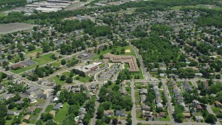 AX83_055 - 5K stock footage aerial video of suburban homes and school in South Plainfield, New Jersey