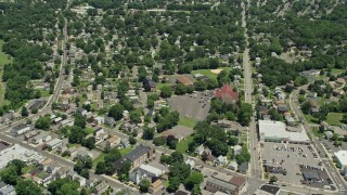 AX83_056 - 5K stock footage aerial video flying over suburban homes and reveal sports field, South Plainfield, New Jersey