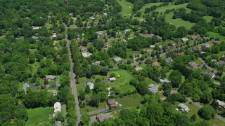 AX83_059 - 5K stock footage aerial video flying over suburban neighborhood beside the Ash Brook Golf Course in Edison, New Jersey