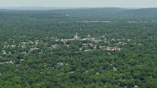 AX83_061 - 5K stock footage aerial video of a church steeple rising above buildings in small town of Westfield, New Jersey