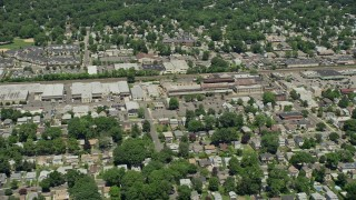 AX83_064 - 5K stock footage aerial video flying over homes near warehouse buildings and small factory in Garwood, New Jersey