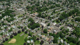 AX83_071 - 5K stock footage aerial video flying over suburban neighborhoods, Union, New Jersey