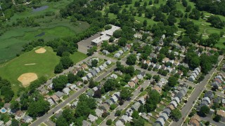 AX83_072 - 5K stock footage aerial video flying over homes and golf course, Union, New Jersey