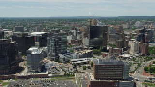 AX83_084 - 5K stock footage aerial video flying by high-rises to reveal Newark Penn Station, New Jersey